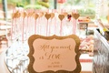 Wedding shower mimosa bar with glittery, gold sign, All you need is love...and Bubbly