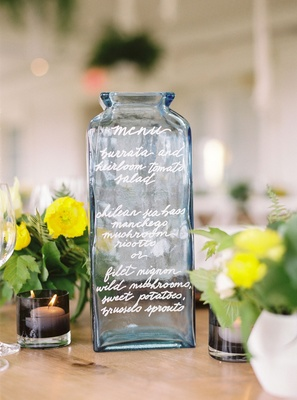 Wedding reception alternative menu idea blue vase vessel bottle calligraphy selections