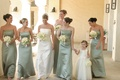 Flower girl with bridesmaids in green gowns