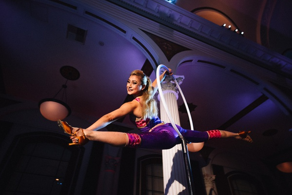 aerial acrobat with hoop performing at wedding reception