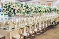 wedding reception table long gold chairs tall centerpieces ballroom wedding