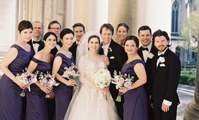 bridal party purple black outside roman catholic church bridesmaids groomsmen dresses suits classic