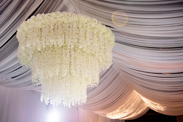 Draped ceiling with white flower chandelier three layer tier tent wedding ideas