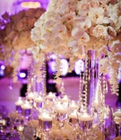 White rose and orchid centerpiece with hanging crystals