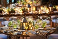 Lantern centerpiece at rustic wedding with striped napkins
