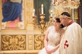Bride and groom at Coptic Orthodox wedding ceremony with gold crowns