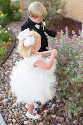 White ruffle flower girl dress and white bow and ring bearer tux