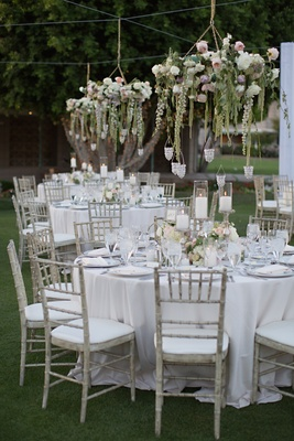 Wedding reception with pastel floral chandeliers on the lawn of Arizona Biltmore