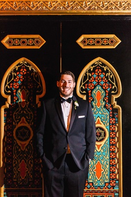 groom in michael kors at fox theatre in atlanta wedding venue
