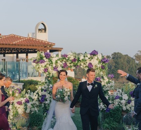 Nick Carter and Lauren Kitt walking up the grass aisle
