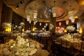 a gold concept with colorful lights and centerpieces of varying heights at new years eve reception