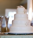 White wedding cake with crystal champagne flutes
