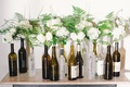 Wedding reception with ivory roses, hydrangeas, peonies, greenery in Robert Mondavi and Chopin vodka