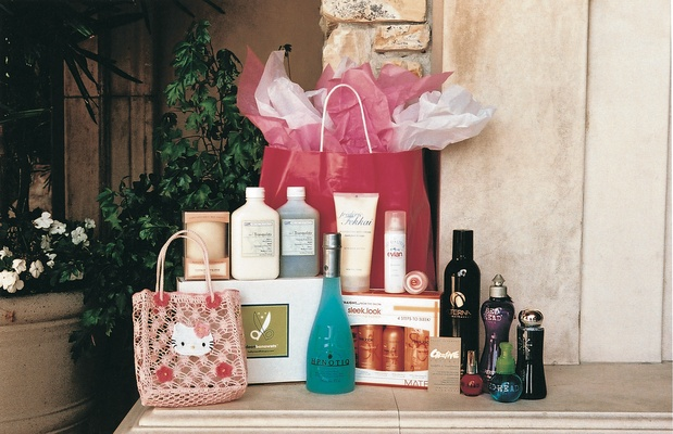 Pink gift bags filled with beauty products