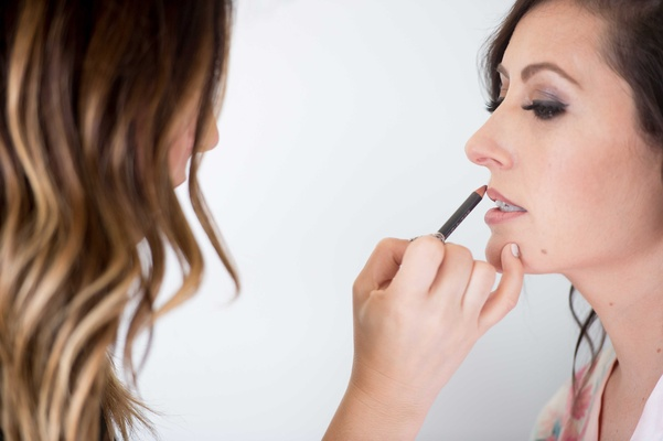 bride getting lip liner lined makeup beauty wedding bridal bride getting ready
