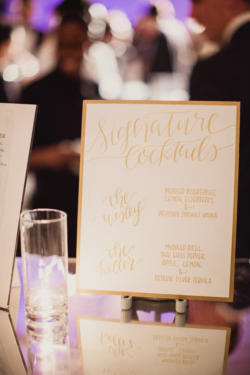 calligraphed sign detailing the signature cocktails