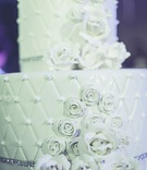 white wedding cake detailed pillow pattern crystals jewels icing destination wedding morocco opulent
