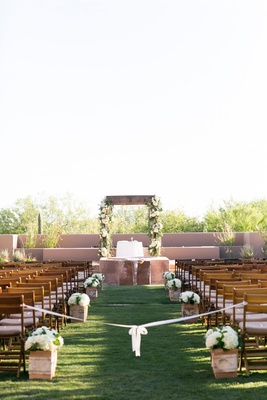 Pueblo style desert outdoor ceremony with rustic elements