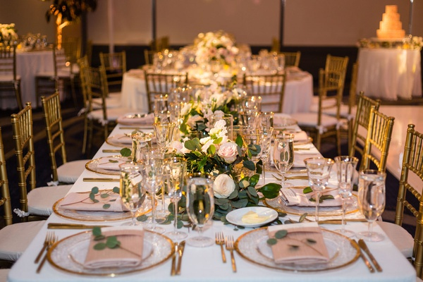 wedding reception long table low centerpiece gold charger eucalyptus pink white rose candles