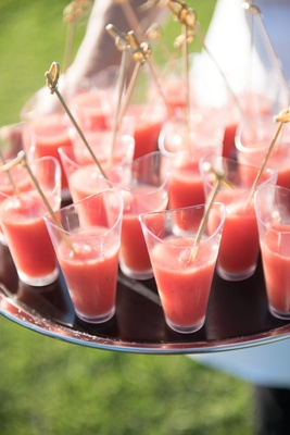 Garden summer wedding with glasses of gazpacho served at cocktail hour