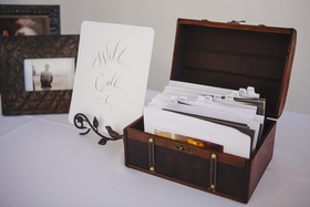 Brown jewelry box with card catalog of wedding escort cards