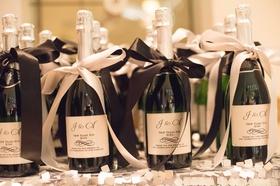 Custom labels on sparkling wine bottle favors