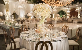 wedding reception white rose gold round table mirror top dance floor chandelier beverly hills hotel