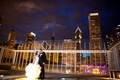 bride in vera wang gown groom in j. crew, Chicago skyline at night