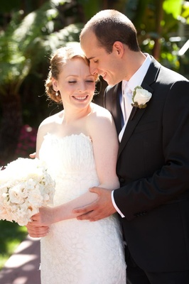 Jewish couple in wedding attire outside