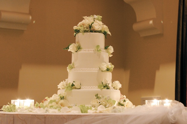 White and green four layer wedding confection