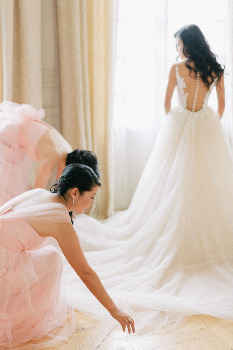 asian bride in berta wedding gown illusion back and full tulle skirt