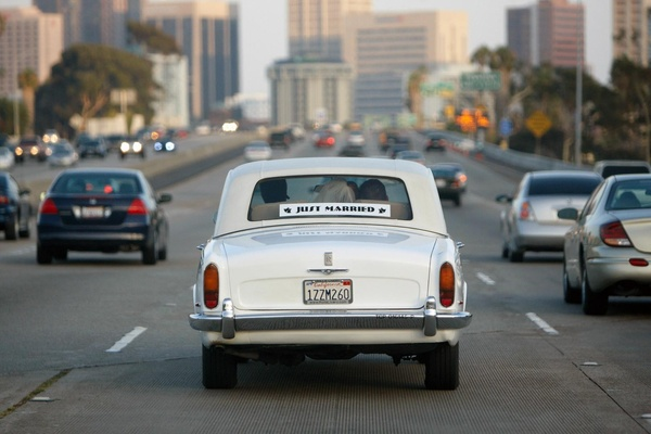 Just Married antique getaway car on freeway