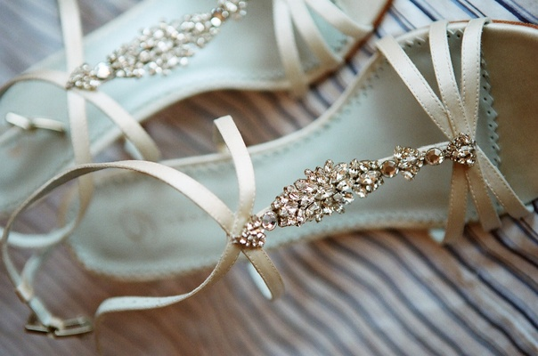 Strappy wedding heels with crystals on top of foot