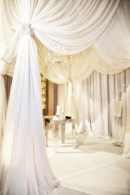 White billowing fabric and mirrored altar tabletop