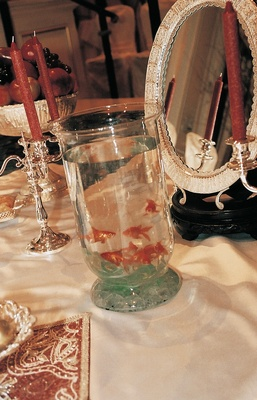 Glass vessel filled with water and gold fish
