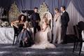 Bride in an Inbal Dror dress, groom in a purple smoking jacket, mother of the bride in a long dress