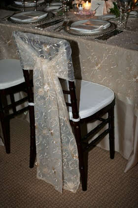 Sheer linen with with gold embroidery on tables and chairs