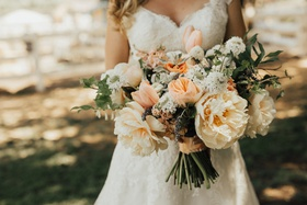 full, lush bridal bouquet with peach peonies and ivory flowers