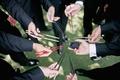 Groomsmen holding mismatched chopsticks