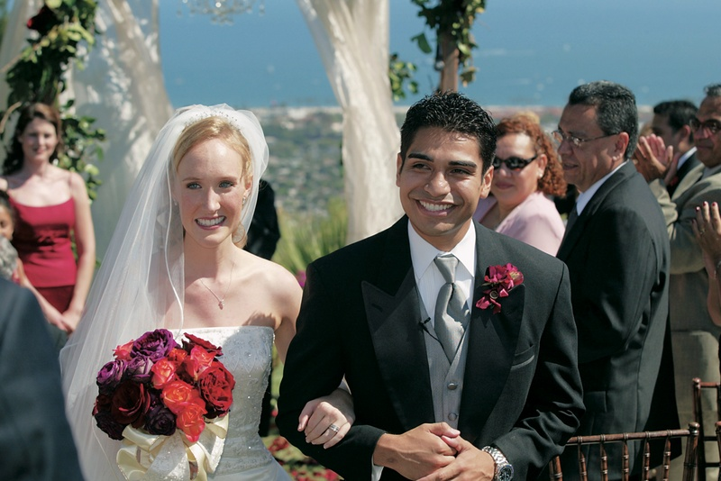 Bride and groom walk up aisle of ocean-view ceremony