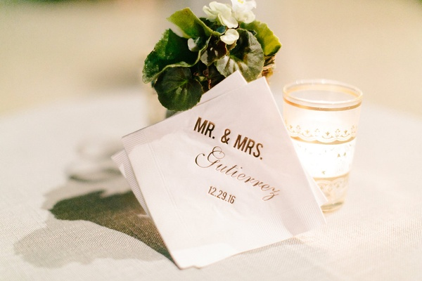 White beverage cocktail napkin with gold foil writing mr and mrs gutierrez wedding date