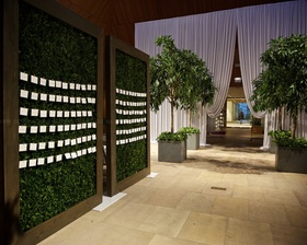 Guests can enjoy finding their names while mesmerizing the boxwood & greens all around.