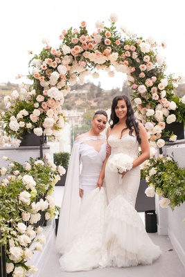 Same sex wedding gay marriage brides wearing Inbal Dror and Michael Costello wedding dresses