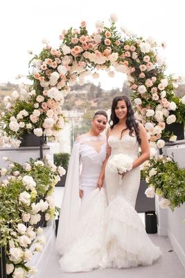 Same sex wedding gay marriage brides wearing Inbal Dror and Michael Costello wedding dresses