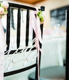 Chair at bridal shower with silver bride to be sign, pink roses, ribbons