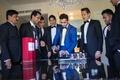 groom in blue suit, groomsmen in black suits, groom pours drinks