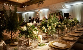 Modern wedding reception chicago long table low centerpiece ideas gold charger plate greenery candle