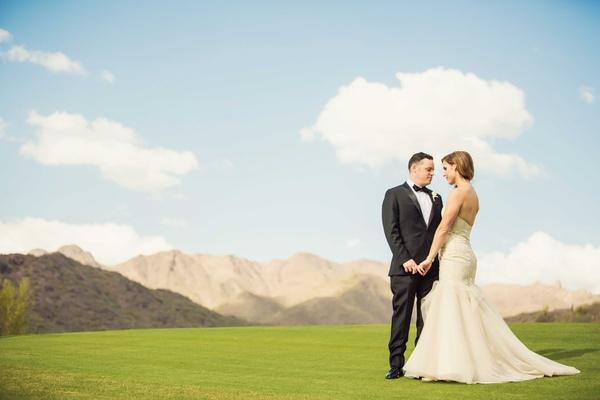 Bride in strapless mermaid Liancarlo wedding dress with groom in tuxedo at Silverleaf Club in AZ