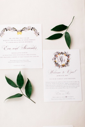 invitation suite decorated with illustrated wreaths of florals and lemons