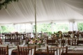 Tent wedding reception rustic theme wood table wood centerpiece pink flowers